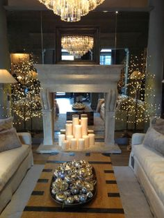 fireplace with candles and mirrors. this setting is perfection