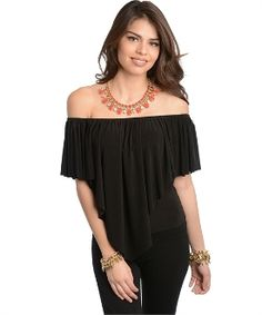 $18.98 This off the shoulder stylish knit top features an inverted triangular flounce top with semi stretch comfy fit material.