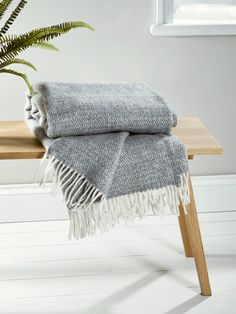 Crafted from pure wool in a subtle shade of grey, our Soft Wool Throw is handwoven in the UK. Finished with elegant white fringing, it drapes beautifully in your home and warms cold shoulders on chilly evenings.Also available in Blush, Navy Bl Sofa Bed Throws, Throw Cushions, Pillows, Blue Couches, Luxury Throws, Blue Throws, Selling Furniture, Blue Blanket, Scandinavian Furniture
