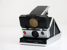 A working Polaroid SX70 Camera. Not only did this camera fold down, but it used sonar-based autofocus. Pretty darn amazing. $270 @Steven McGaughey I thought you'd dig this.
