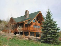 Log home constructed in Stillwater Minnesota. South facing image showing truss glass window.