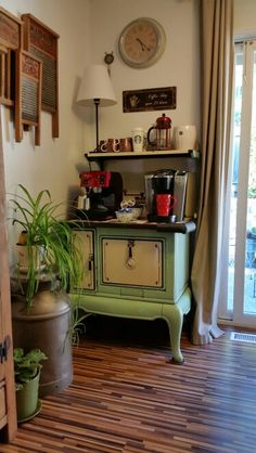 Old country wood stove used as a coffee bar.
