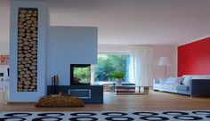 Perfekt inszenierter 3-seitiger Heizkamin mit dekorativer Holzlege. #ModernKamin #OfenModern #Fireplace www.ofenkunst.de