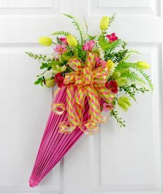You will be ready for Spring showers with this fresh collection of tulips, wildflowers and ferns all in a soft pink paper umbrella. A soft bow tied on the handle blends beautifully with the florals. D