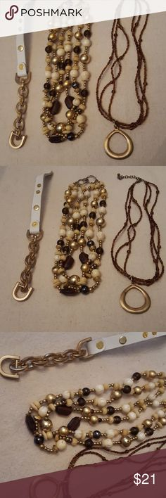 Earth tone jewelry lot 2 necklaces and a bracelet Lot of two necklaces and a bracelet. One necklace has three strands of chunky earth tone beads and the other one is made of tiny brown seed beads and a gold metal pendant. The bracelet is made with white leather and gold tone hardware.  Nice pre owned shape. Jewelry