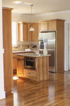 Hickory Cabinets with multi tone floors
