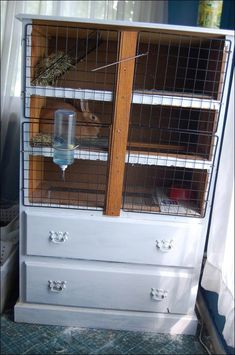 Rabbit hutch from old dresser/chest of drawers -- Mobile Home Woman/ I also have an old shabby chic headboard which I may upcycle into a hutch or coop somehow...hmmm ideas are starting to flow... by jannie