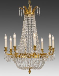 Style#LCC-20-Crystal and cast brass eight light chandelier. Shown in standard golden brass finish.