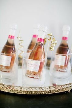 12 Best Edible Wedding Favors: Time to get it popping! Guests can continue the celebration after the party ends with mini bottles of pink champagne. Mini Champagne Bottles, Mini Bottles, Pink Champagne, Champagne Party, Champagne Cupcakes, Edible Wedding Favors, Party Favors, Wine Favors, Edible Favors