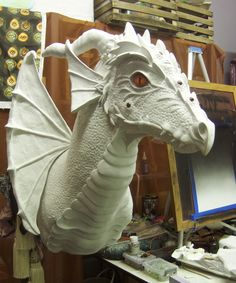 This is a Dragon head I'm making for Lori. I only have one wing done, after the wings are sculpted I have to prime and paint. Air dry clay, work in progress