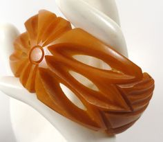 Heavily carved bakelite bracelet from Ruth at Heads up Collectibles on Ruby Lane, great detail on this piece and priced at 195.00.