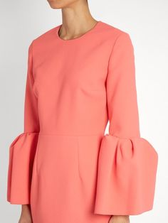 The Margot dress is a Roksanda favourite, and for AW16 it's energised in punchy flamingo-pink crepe. Precise darts ensure the waist nips in to flattering effect, while voluminous bell sleeves shake up the silhouette. Ground with chunky black sandals, and maximise the femininity with a pearl-encrusted clutch.