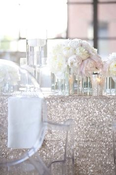 Love the flowers and glitter table cloth!