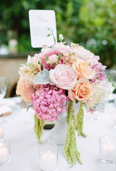 Romantic centerpieces for a wedding diner with Sweet Avalanche and Pearl Avalanche byMeijer Roses! (photo by Jessica Burke)—