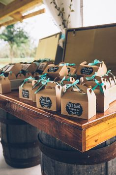 "Sweet treat wedding favor idea - treats in cardboard boxes with turquoise ribbon and ""Life's sweet so have  a treat"" labels {Darin Crofton Photography}"