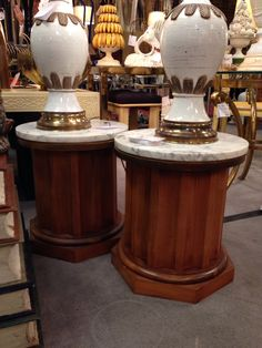 Pair of Italian wood and marble column side tables.  Visit me in space 34 at the Antique and Design Center of High Point.