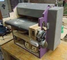 Thickness Sander - Homemade drum/thickness sander featuring a motorized infeed roller. constructed from plywood, MDF, lumber, aluminum, brass, steel, and hardware.