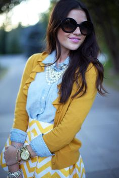 Chambray shirt + Mustard Chevron ruffle cardigan + mustard and white chevron skirt + multi string necklace + big watch + gold arm candy on one arm + silver arm candy on the other.This is serious daytime STYLE!