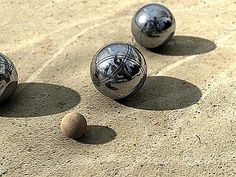 Le jeu de boules - La Pétanque --- Pétanque is a game derived from the Provençal game balls. This is the eighth sport in France by the number of licensees: 362 867 registered players (end 2007) [1], there are many national federations affiliated to the International Federation. End 2007, there were 558,898 licensed in 78 countries, from Algeria to Vietnam. (They do take this game very seriously!)