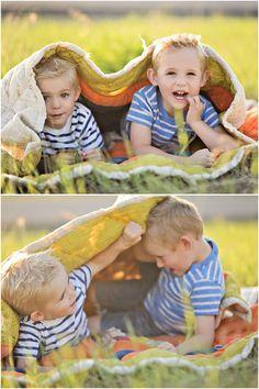 Boys under blanket photo