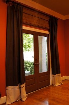 """Adding additional material to the botom of a cheap curtain to make it   full length"""" and have more character."""
