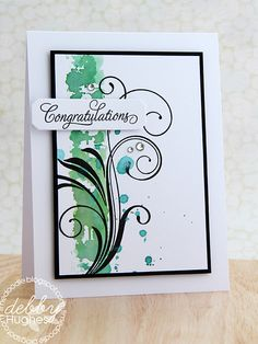 I wanted to try a technique of patting distress inks onto an acrylic block, spritzing with water and then putting the stamp to the ink before pressing on card. So I got my modern basics stamp and did the above imagining a blue/green graphic pattern going up the left of my white panel.