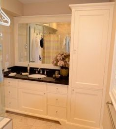 Maple vanity with linen tower transitional-bathroom