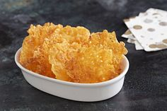 You can't beat this tasty appetizer for simplicity. Mix crushed BBQ potato chips with shredded cheddar—then bake until golden brown.