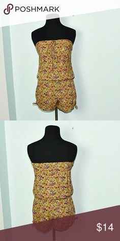 Adorable Strapless Floral Print Romper In excellent condition! Very cute, flowy, and stretchy! Buy 3 items and get 1 free plus 15%off your purchase total! Pants Jumpsuits & Rompers