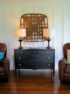 I love this tobacco basket hung on the wall.  Would be better with a different color dresser. Maybe Aqua?