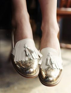 White and gold fringed brogues.