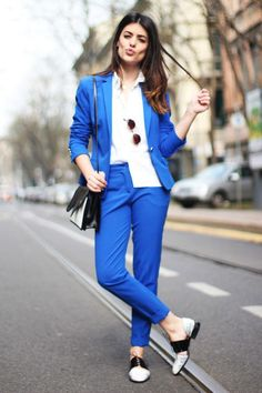 Aida Domenech opts for color with a bright shade of blue but makes sure to keep her shoes and accessories neutral.
