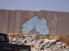 wall near near West Bank of Palestine! The other side is the I abode the Jews live in!