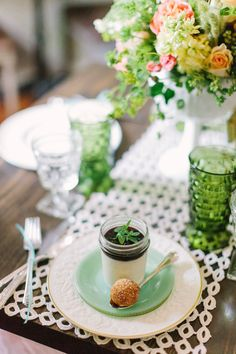 Green and Coral wedding inspiration, Southern Vintage table setting vintage rental- vintage plates, silver plate flatware, vintage stemware, green goblets and clear wine glasses. vintage lace runners, antique bottles. Photography of Haley Sheffield