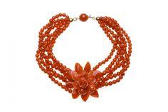 """PG25:Bracciale con 6 fili di pallini di corallo rosso del Mediterraneo di 4 mm:, abbellito da un elemento """"foglie e fiori"""".Lunghezza cm.20, montatura in oro 18 kt con sfera di corallo rosso di 9mm."""