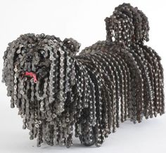 Chain Dog Sculptures With scavenged bicycle chains, gears and other parts, Israeli artist Nirit Levav creates sculptures of shaggy dogs.With scavenged bicycle chains, gears and other parts, Israeli artist Nirit Levav creates sculptures of shaggy dogs. Sculpture Metal, Dog Sculpture, Sculptures, Metal Yard Art, Scrap Metal Art, Recycled Bike Parts, Bike Chain, Bicycle Art, Junk Art