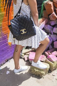 Chanel backpack + Lacoste sneakers // via chicityfashion.com