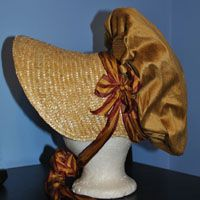 Regency bonnet - A lovely new style, this poke bonnet features a cloth covered crown with contrasting ribbons, bows and ties. Patterend ribbon in stripes or plaids makes a bold statement while solid color satin ribbons look charming as well.