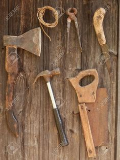 carpentry tools: Antique rusty tools on an old wooden desk