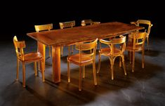 Rolf Sachs' Spitting Image dining table and chairs are cast from urethane resin.