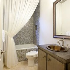 a shower curtain from floor to ceiling to make the room look more luxurious