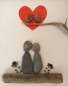 Pebble art of couple sitting on driftwood with pebbles flowers on either side with two love birds on a branch inside a red heart. Frames in a black frame with outer dimensions Sand Crafts, Rock Crafts, Fun Arts And Crafts, Crafts To Make, Art Couple, Pebble Art Family, Pebble Pictures, Rock And Pebbles, Crafts With Pictures