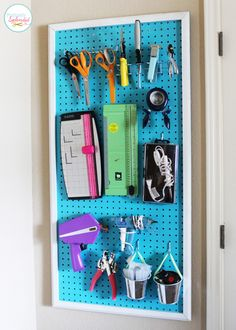 Tame your crafting clutter with a framed pegboard organizer. So easy to DIY! #organization
