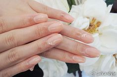 Nude manicure with delicate pearl accents.