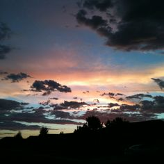 Sunset over our street.  iPhone photo taken by Michele Snider