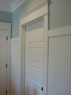 Cobblestone Farms: In my new Laundry Room. horizontal panel doors, beadboard with simple shaker-type header, and my favorite trim work over the doors. Beadboard Wainscoting, Wainscoting Bedroom, Wainscoting Panels, Wainscoting Ideas, Bathroom Beadboard, Bedroom Doors, Small Bathroom, Bathroom Ideas, Door Molding