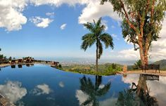 Strawberry Hill's spectacular cliff-hanging infinity pool, with a 40-mile view overlooking the city of Kingston.
