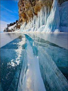 Turquoise ice lake baikal. Russia