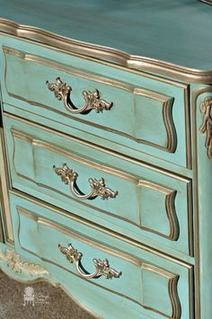 similar silver leafing treatment to trim on dresser but with different knobs…