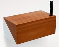 during a collaborative workshop organized by dutch furniture company arco. both a shelf and a container, this interactive unit  draws its mechanics from the parallel hinging strips of vintage sewing boxes, the kind that arco used to make in its earlier years.  the result is a wall-mounted bread bin which is split along a diagonal plane and joined by parallel hinges concealed inside.  with deli...